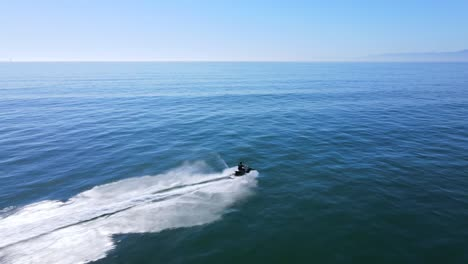An-Excellent-Aerial-Shot-Of-A-Man-Jet-Skiing-On-Clear-Water-1