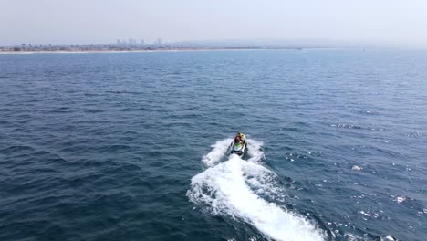 An-Excellent-Aerial-Shot-Of-A-Couple-Jet-Skiing-Far-From-The-Coast