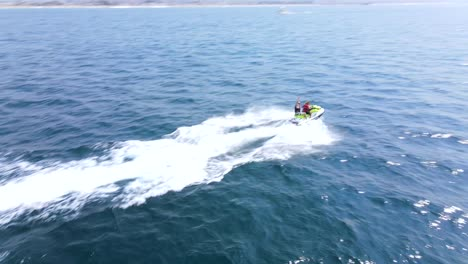 An-Excellent-Aerial-Shot-Of-A-Couple-Jet-Skiing-Together