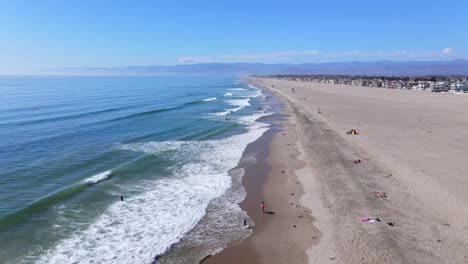 An-Excellent-Vista-Aérea-Shot-Shows-People-Playing-In-The-Surf-On-A-Beach-In-Oxnard-California