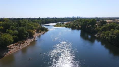 An-Excellent-Aerial-Shot-Of-People-Boarding-Personal-Watercrafts-On-The-American-River-In-Sacramento-California