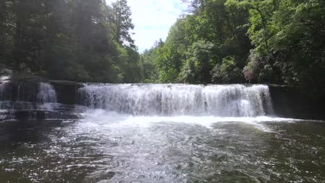 Excellent-Drone-Footage-Of-A-Small-Waterfall-Surrounded-By-Greenery-In-North-Carolina