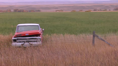 An-Abandoned-Pickup-Truck-Sits-In-A-Field