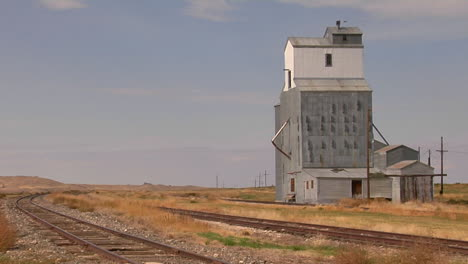 An-Abandoned-Grain-Elevator-Stands-Along-A-Stretch-Of-Railway-Track