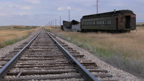 An-Old-Abandoned-Pullman-Railway-Car-Sits-On-A-Siding-Along-A-Lonely-Stretch-Of-Railroad-Track