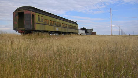 An-Old-Abandoned-Pullman-Railway-Car-Sits-On-A-Siding-Along-A-Lonely-Stretch-Of-Railroad-Track-1