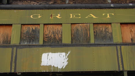 A-Railway-Car-That-Has-Great-Northern-Painted-On-It-Stands-Alone-With-Boarded-Windows