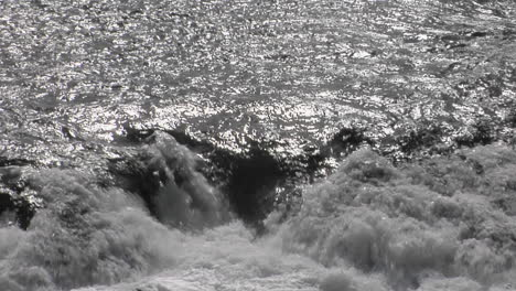 Water-Tumbles-Over-Rocks-In-A-River