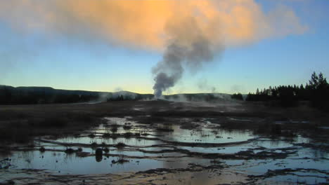 A-Geyser-Sends-Steam-Into-The-Sky-At-Yellowstone-National-Park