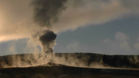 Steam-Billows-Out-Of-Old-Faithful-At-Yellowstone-National-Park