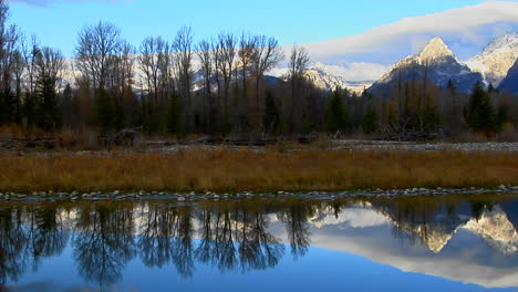 The-Grand-Teton-Mountains-Are-Perfectly-Reflected-In-A-Mountain-Lake-1