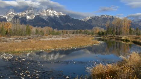 The-Grand-Teton-Mountains-Are-Reflected-In-A-Mountain-River