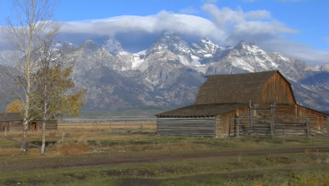 An-Old-Barn-Stands-With-The-Grand-Teton-Mountains-In-The-Background