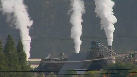 Smoke-Billows-Out-Of-Three-Stacks-Of-A-Factory