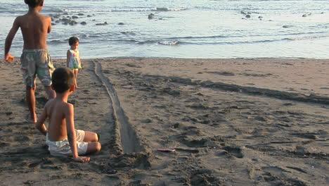 Children-Roll-Bottle-Caps-Down-A-Narrow-Track