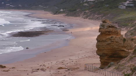 A-Person-Walks-Along-A-Lonely-But-Scenic-Beach