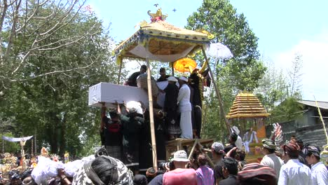 A-Body-Is-Loaded-Into-The-Back-Of-A-Platform-In-A-Balinese-Cremation-Ceremony