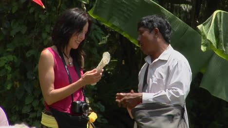A-Tourist-And-A-Merchant-Discuss-An-Object-In-Indonesia