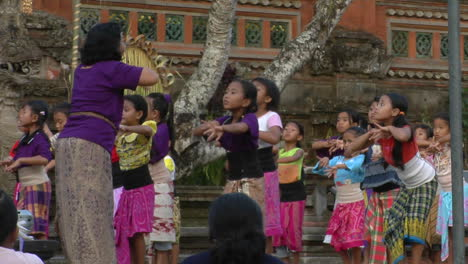 A-Woman-Leads-A-Group-Of-Girls-In-Dance-Movements-At-An-Indonesian-Ceremony