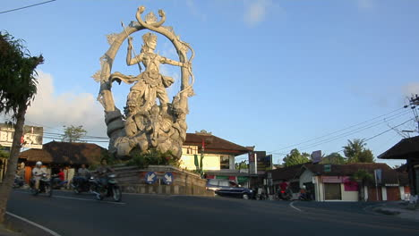 A-Giant-Statue-Of-A-Hindu-God-Stands-At-The-Center-Of-An-Intersection-In-Bali-Indonesia