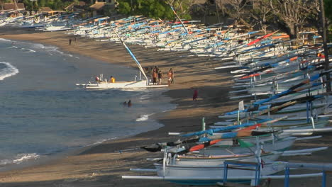 Colorful-Boats-Are-Pulled-Up-Along-A-Beach-In-Indonesia