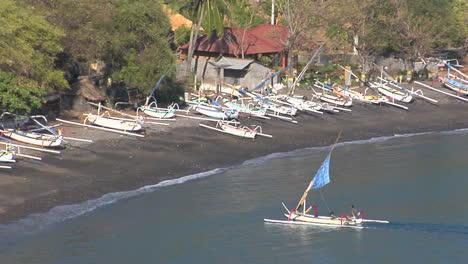 A-Catamaran-Style-Boat-Motors-Into-A-Sandy-Beach