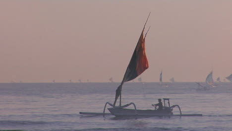 People-Row-A-Fishing-Boat-To-Into-Shore-Off-The-Coast-Of-Southeast-Asia