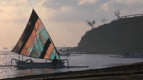 A-Catamaranstyle-Fishing-Boat-Comes-Into-Shore-2