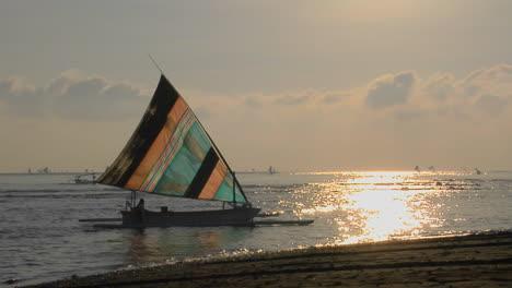 A-Colorful-Sailboat-Approaches-A-Shoreline