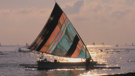 A-Man-Guides-A-Sailboat-To-Shore