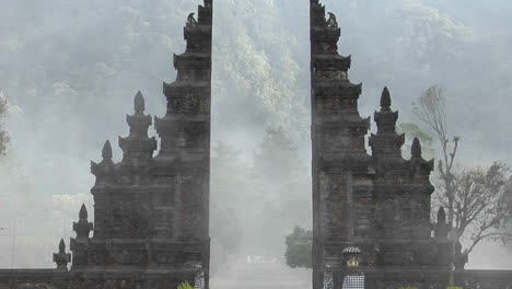 The-Fog-Drifts-By-A-Traditional-Balinese-Temple-Gate-In-Bali-Indonesia-1