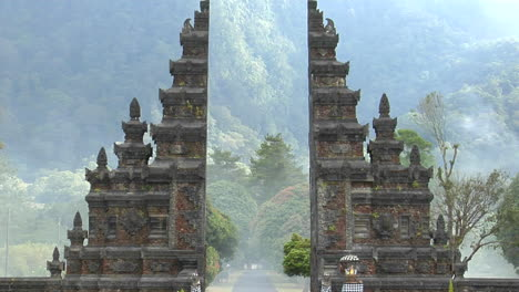 The-Fog-Drifts-By-A-Traditional-Balinese-Temple-Gate-In-Bali-Indonesia-2