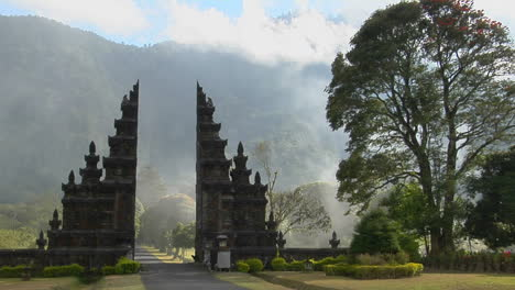 Fog-Drifts-By-A-Traditional-Balinese-Temple-Gate-In-Bali-Indonesia