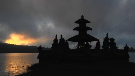 A-Balinese-Temple-Overlooks-Reflections-In-A-Lake-1