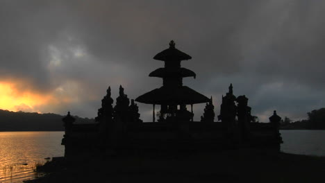 A-Balinese-Temple-Overlooks-Reflections-In-A-Lake-3