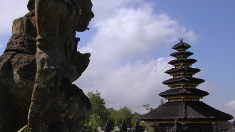 A-Statue-Of-A-Balinese-God-Looks-Out-Over-The-Besakih-Temple-Complex-In-Bali-Indonesia
