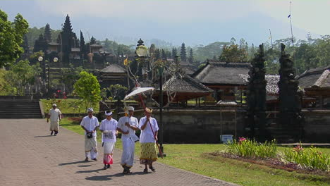 A-Religious-Procession-Passes-By-Besakih-Temple-In-Bali-Indonesia