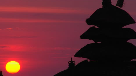 The-Pura-Tanah-Lot-Temple-Stands-In-Silhouette-Against-A-Glowing-Sky-1