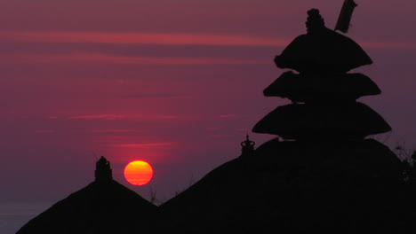 The-Pura-Tanah-Lot-Temple-Stands-In-Silhouette-Against-A-Glowing-Sky-3