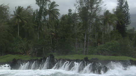 A-Large-Pacific-Storm-Batters-A-Tropical-Island-With-Large-Waves