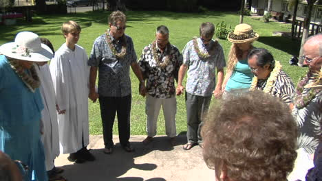 A-Prayer-Circle-Of-Hawaiian-Worshippers-Outside-A-Church