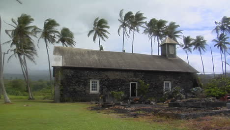 A-Church-Stands-On-A-Tropical-Island-During-A-Wind-Storm-1