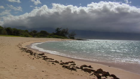 Waves-Roll-Into-A-White-Sand-Beach-In-Hawaii