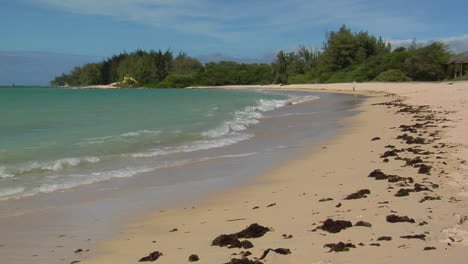 Waves-Roll-Into-A-White-Sand-Beach-In-Hawaii-1
