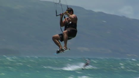 A-Windsurfer-Glides-Across-A-Sparkling-Ocean