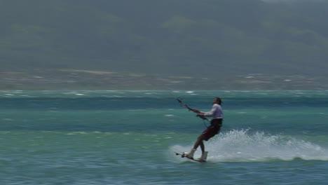 A-Windsurfer-Glides-Along-The-Ocean