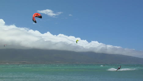 A-Wide-Shot-Of-A-Windsurfer-Against-A-Hawaiian-Landscape