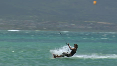 A-Windsurfer-Glides-Across-The-Ocean-And-Wipes-Out-After-A-Stunt