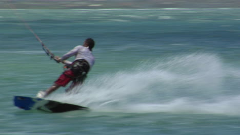 A-Windsurfer-Glides-Along-And-Makes-A-Sudden-Turn