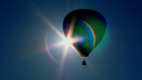 A-Hot-Air-Balloon-Crosses-Against-The-Sun